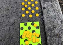 Tactile paving discs as road signs for blind people